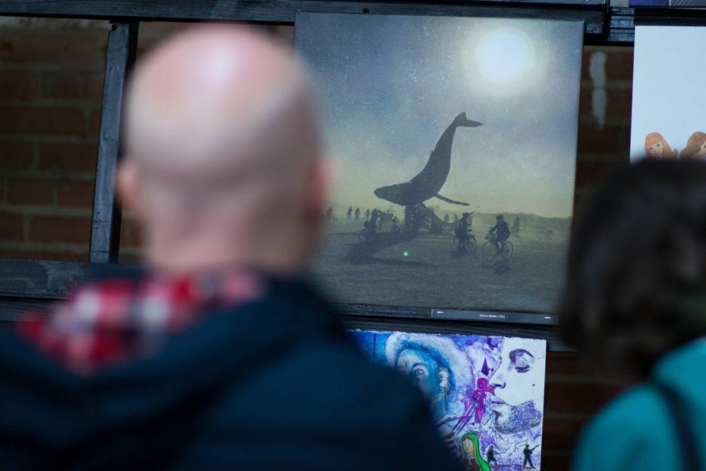 Man viewing paintings